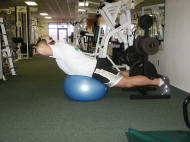 back strength training : reverse hyperextension on a ball